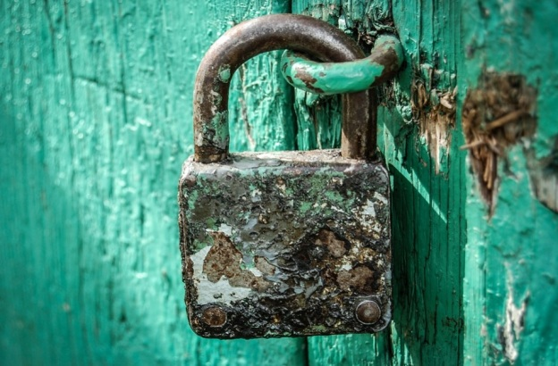 Lock on green background